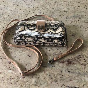 Sakroots crossbody wallet-style purse.